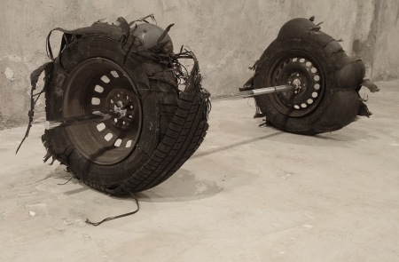 NOT YET by Ovidio project, tires, inner tube, barbell, 220x60x70 cm, view in the studio, Catania, 2014