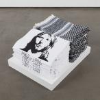 Emily Jacir Bethlehem street corner 1998 10 keffiyehs, 10 Cobain t-shirts 6 1/2 x 17 1/2 x 13 in/16.5 x 44.5 x 33 cm Courtesy of Alexander and Bonin Gallery