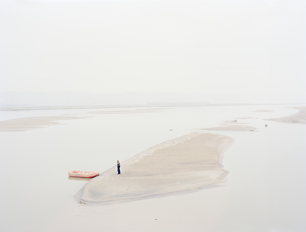Zhang Kechun, A Man Standing on an Island in the Middle of the River Shaanxi, China, 2012