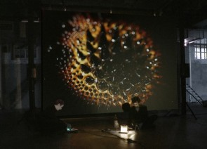 "Hicham Berrada, Rapport de lois universelles, 2012, Performance, 3'40"", Beaker, chemicals, iron nano-particules, camera and live screening. Image courtesy of Hichal Berrada and Kamel Mennour."